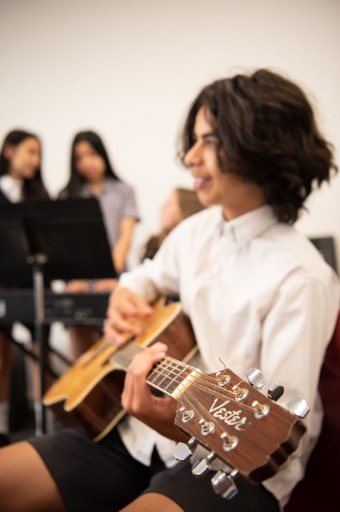 Middle School Year 8 Student with Guitar
